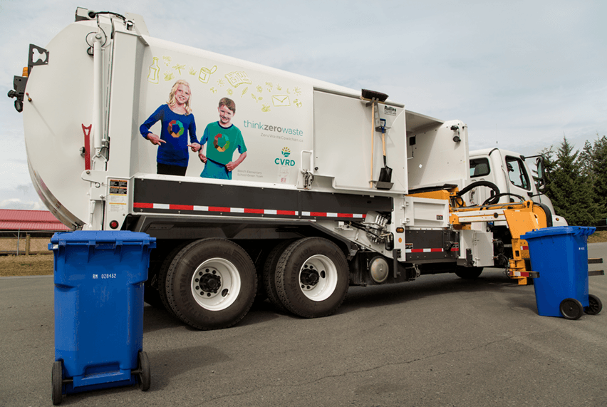 Picture of a curbside collect truck for garbage and recycling.