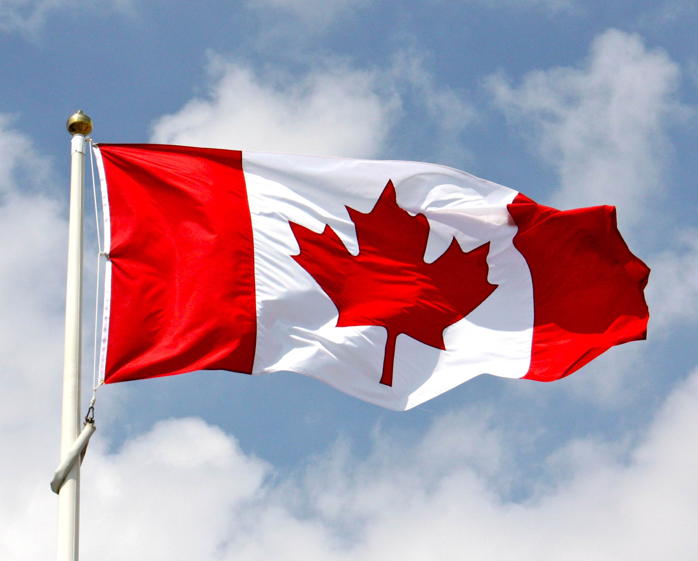 canadian-flag-waving-in-the-blue-sky2